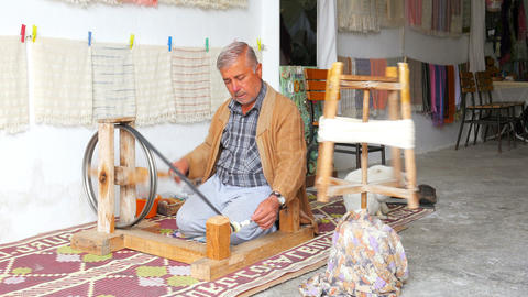 FETHIYE, TURKEY- MAY 2015: turkish man weaving loom machine Footage
