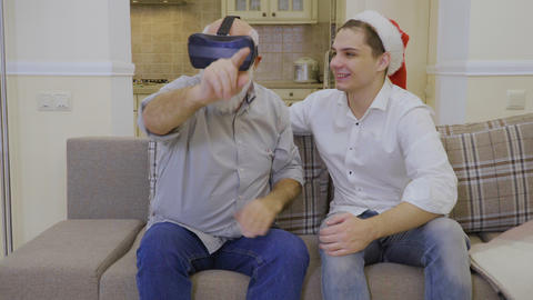 Young guy open a virtual world to his grandfather Footage