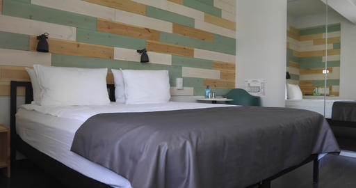 Comfortable bed in stylish bedroom in hotel 영상물