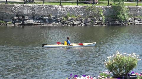 Man paddling kayak on calm water 영상물