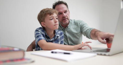 Father helping son with homework Footage