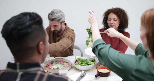 Female serving friends salad at a meal Footage