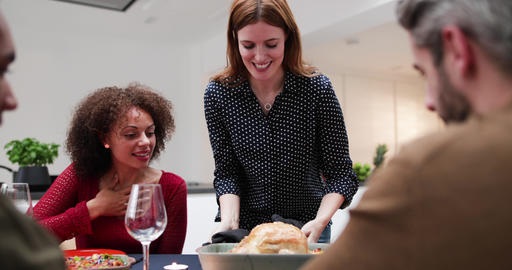 Adult female serving Christmas meal to friends Footage