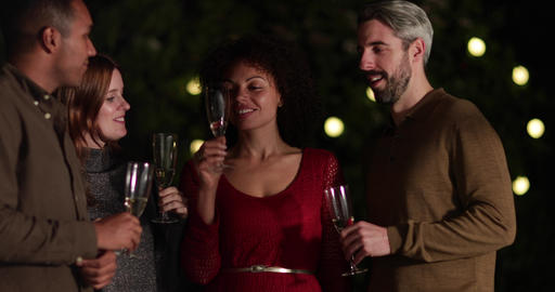 Friends drinking champagne outdoors at night Footage