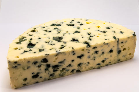 Half moon of Roquefort cheese from France フォト