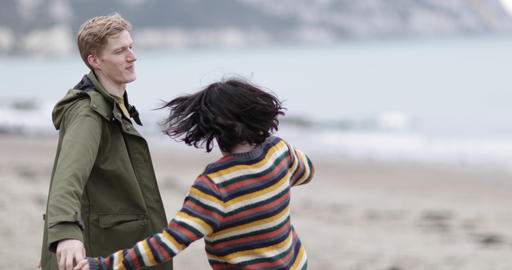 Young couple dancing on a beach in winter Live Action