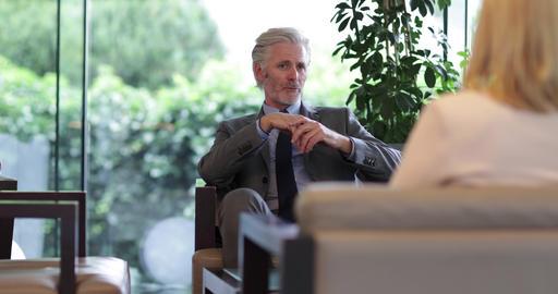 Senior business executive interviewing a businesswoman Live Action