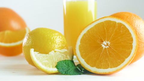 Closeup slow motion video of camera panning along assortment of citrus fruits Footage