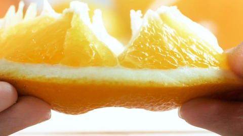 Closeup slow motion video of juice bursting from orange... Stock Video Footage