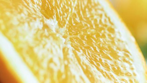 Macro slow motion video of squeezing orange half Footage