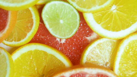 Closeup video of slices of citrus fruits lying on table Footage