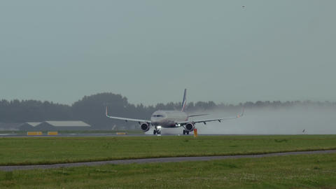 Airbus A320 of Aeroflot airlines accelerates on wet runway Footage