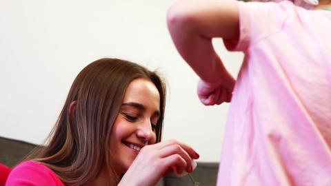 A little girl pops a soap bubble in slow motion Footage
