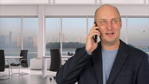 Businessman talking to mobile phone in office on background window GIF