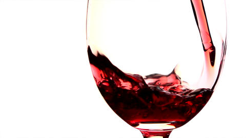Red wine poured into glass on white background GIF