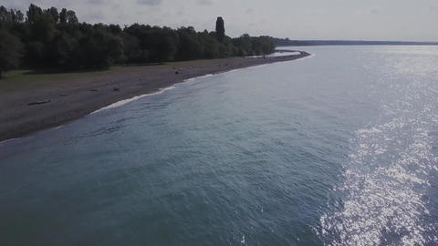 Flight over the wild beach. Mountains and cliffs Footage
