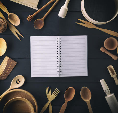 open notebook in a line on a black table Photo