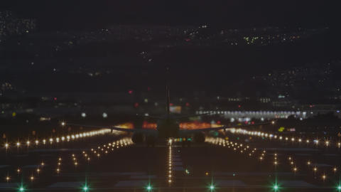 Airplane to take off from the airport at night - back view 영상물