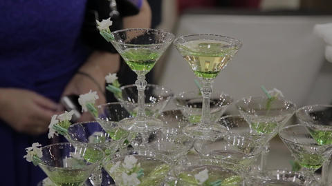 The guests' hands take glasses with bubbling wine at the party. Glasses are GIF