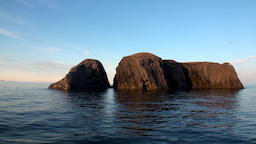 Stone rocks among water surface of Arctic Ocean on New Earth Footage