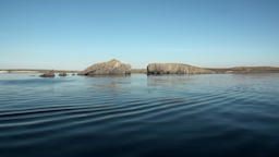 Stone rocks among water surface of Arctic Ocean on New Earth Vaigach Island Footage