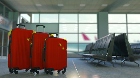 Travel suitcases featuring flag of China. Chinese tourism conceptual animation Footage