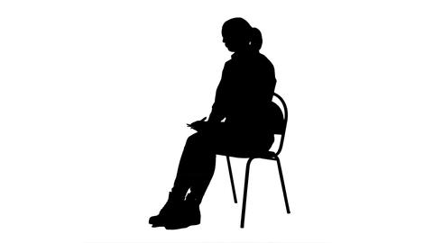 Silhouette Female doctor writing recipe for a patient Footage