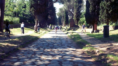 cyclists cycling on the ancient Appia フォト