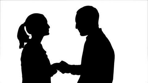 Silhouette Teen people shaking hands and looking at camera Footage
