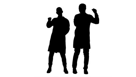 Silhouette Young doctors in a good mood dancing and singing songs Footage