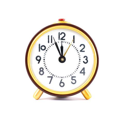 Retro clock isolated on white background. Close up Photo