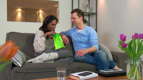 Husband Giving Wife Birthday Present Anniversary Gift Surprise On Sofa Footage