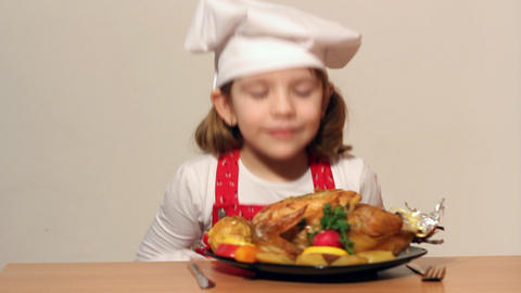 Little girl cook with grilled chicken Footage
