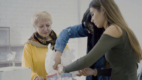 Three designers make paper origami in the studio Footage