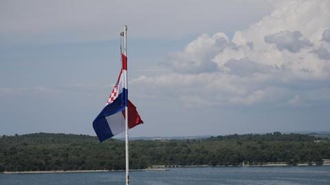 Croatian flag at waterfront, Pula, Croatia Footage