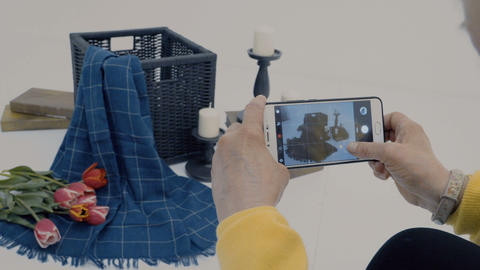 Photographer make photo of composition on smartphone in photostudio Footage