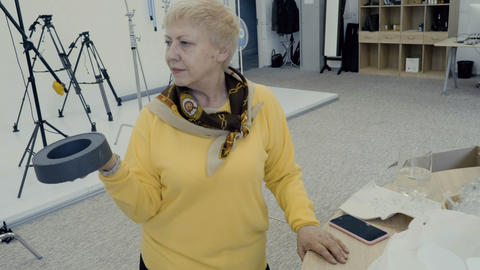 Photographer make photo of old woman in photo studio Footage