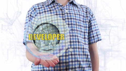 Young man shows a hologram of the planet Earth and text Developer Live Action