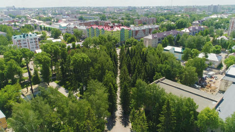 park with eternal fire monument to soldiers among cityscape Footage