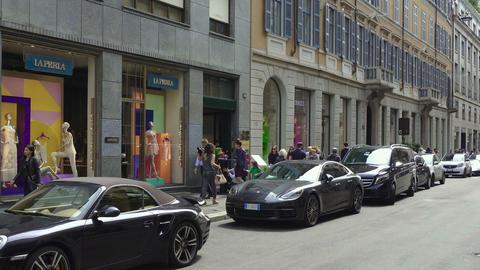 Milan, Italy Via Monte Napoleone fashion district with luxury cars 영상물