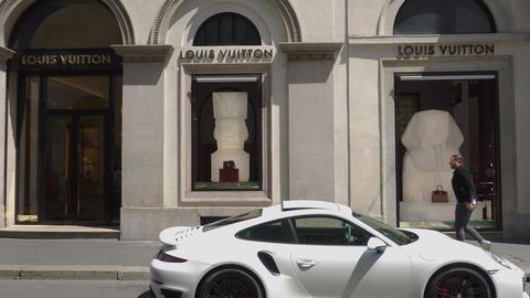 Milan, Italy Via Monte Napoleone fashion district with luxury car 영상물