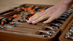 Girl builder touches tools in toolbox with her hand, repairing conception Footage
