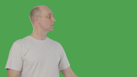 Adult man pointing hand to side on something isolated on green background. Alpha GIF