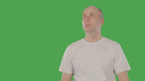 Bald man thinking and touching his chin with finger and inventing original idea Footage