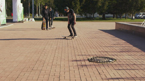 guy rides and falls down from skateboard on square Footage
