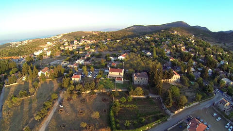 Aerial village landscape, mountains and the sea on distance. Summer vacation to Footage