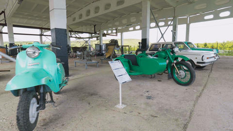 retro motorcycles and automobiles stand at exhibition Footage