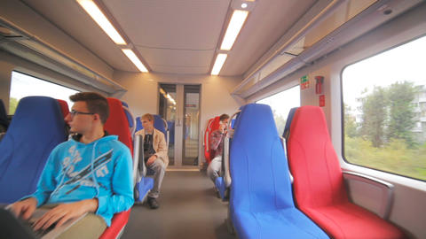 passengers sit in cozy armchairs of electric train Footage