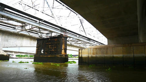 Passenger boats are bridges on the Chao Phraya River during heavy rains Footage