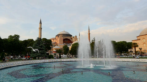 Slow motion birds fly over Hagia Sophia (Aya Sofya) museum and fountain view GIF